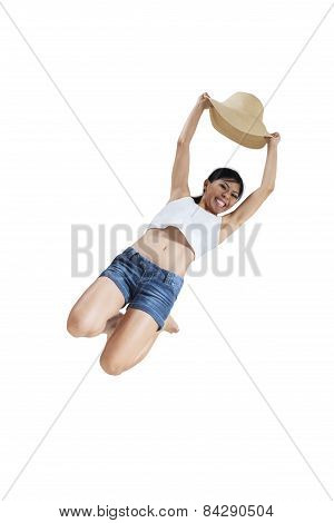 Joyful Girl Jumping In The Studio With Hat