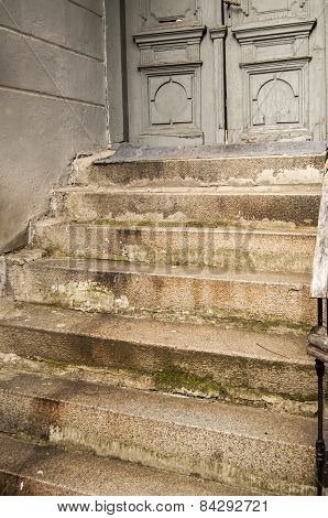 Old stone staircase and door