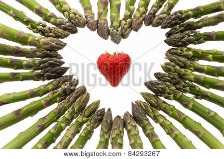 Strawberry Amidst A Heart Made Of Asparagus Spears