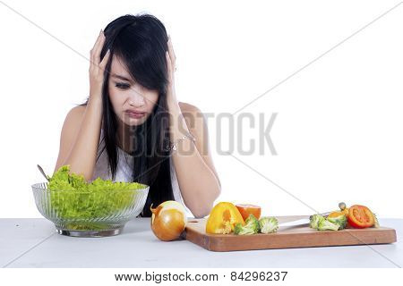 Woman Hesitate To Eat Salad 1