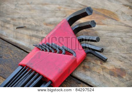 Hex set of hand tools on wooden background, Tools equipment.
