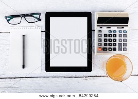 Tablet And Touch Phone With Isolated Screen Lie On A Wooden With A Cup Of Coffee