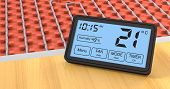 pic of programmers  - close up view of a floor heating system with a programmable thermostat celsius  - JPG