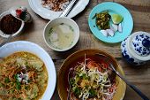 stock photo of thai food  - a dining table with various Thai local food in Northern style - JPG