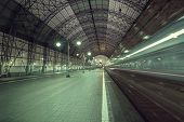 foto of high-speed train  - High speed train departs from the station at night time - JPG