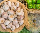 image of sag  - close up shot of garlic pumpkin and chili in basket image - JPG