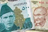 stock photo of gandhi  - Banknotes from Pakistan and India showing heroes of the two nations - JPG