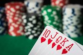 image of flush  - hearts straight flush with poker chips on green table - JPG