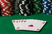 stock photo of flush  - hearts straight flush with poker chips on green table - JPG