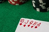 pic of flush  - diamonds straight flush with poker chips on green table - JPG