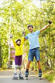 stock photo of daughter  - portrait of a sports dad and daughter in a helmet - JPG