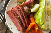 stock photo of corn  - Homemade Corned Beef and Cabbage with Carrots and Potatoes - JPG
