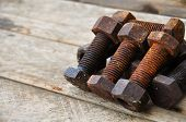 picture of bolt  - Old bolts or dirty bolts on wooden background - JPG