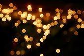 stock photo of gold-dust  - Festive background with natural bokeh and bright golden lights - JPG