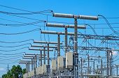 stock photo of transformer  - Image of high voltage transformer station against the blue sky - JPG