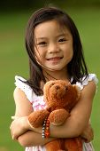picture of little girls  - Asian Girl With Her Brown Bear - JPG