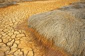 stock photo of global-warming  - Hay on drought land amazing arid and cracked ground climate change made agriculture plantation have to reduct in summer it very hot warming is global problem cause by greenhouse effect - JPG