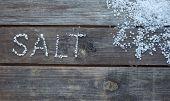 picture of sea salt  - word salt written with sea salt crystals - JPG