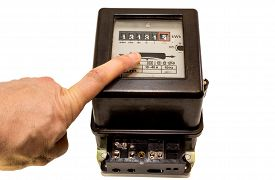 pic of electricity meter  - finger indicating the number on the meter counter of electricity - JPG