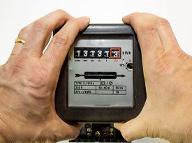 picture of electricity meter  - hands tightened around the electrical energy meter - JPG