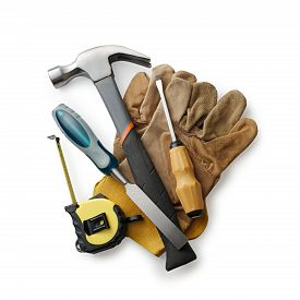 stock photo of chisel  - Leather working gloves with carpentry tools including a claw hammer tape measure chisel and screwdriver in a construction woodworking or DIY concept - JPG