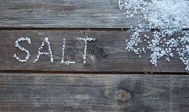 stock photo of crystal salt  - word salt written with sea salt crystals - JPG