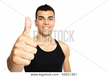 Young man shows you thumb up