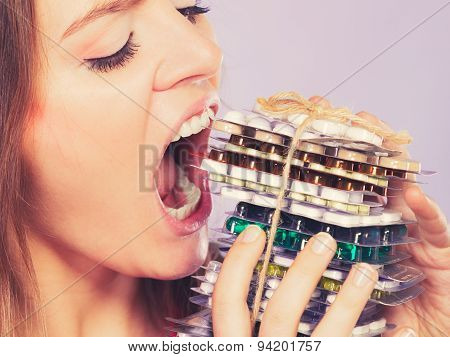 Woman Taking Eating Pills Tablets. Drug Addict.