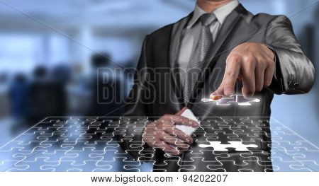 Businessman Working On Digital Jigsaw Screen, Business Strategy Concept