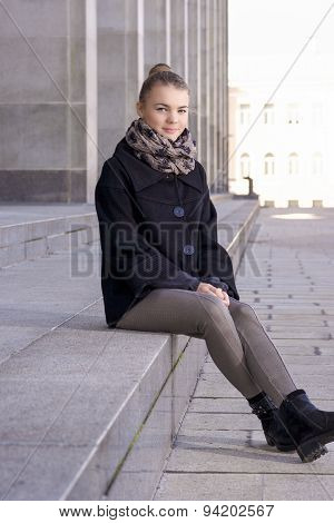 Portrait Of Happy Caucasian Teenager Girl Relaxing Outdoors