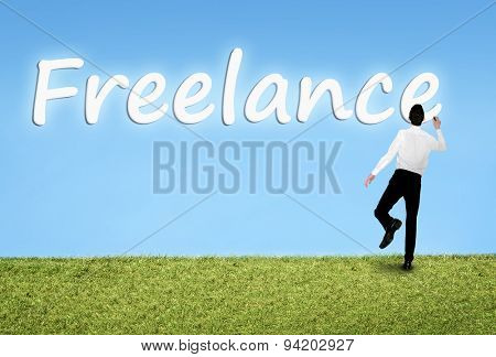 Business man writing on sky Freelance word