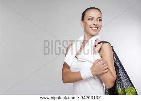 Healthy Lifestyle Concept: Closeup Portrait Of Professional Female Tennis Player Holding Plenty Of B