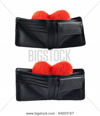 Plush heart in a wallet isolated