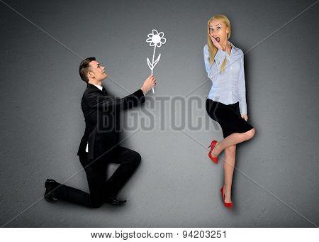 Business man giving flower to girlfriend