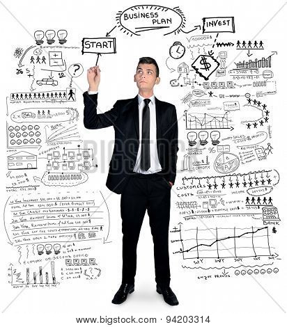 Isolated business man writing business plan