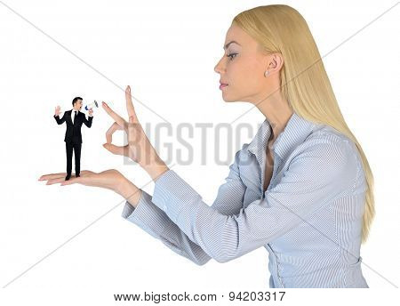 Isolated business woman finger flipping on little man