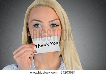 Beautiful woman holding card with Thank you word