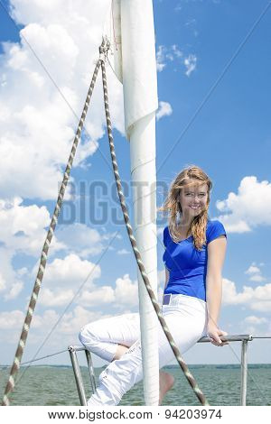 Cheerful Caucasian Female Travelling Under Sale And Sitting On Handrails