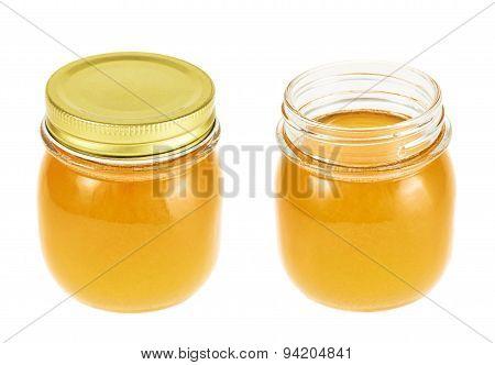 Closed and opened honey jar
