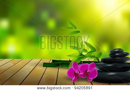 Stone, flower, wax and bamboo on the wood background