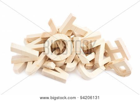 Pile of wooden block letters isolated