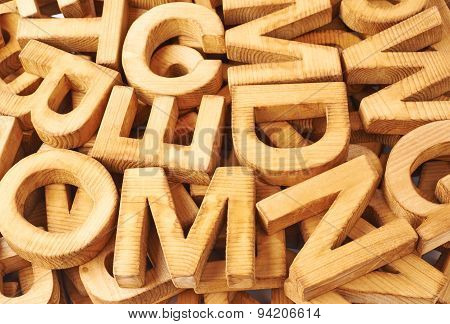 Surface covered with multiple wooden letters