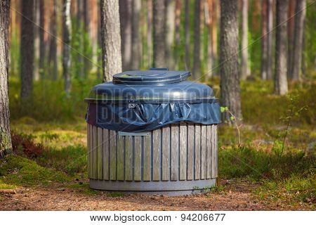Big refuse bin in forest for tourists.