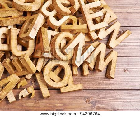 Pile of wooden letters over the wooden surface