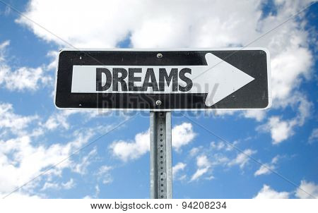 Dreams direction sign with sky background