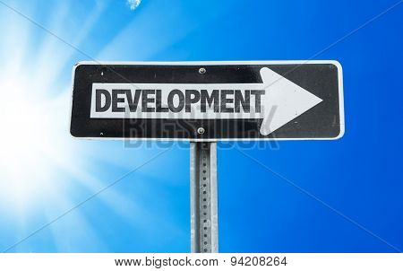 Development direction sign with a beautiful day