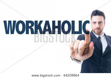 Business man pointing the text: Workaholic