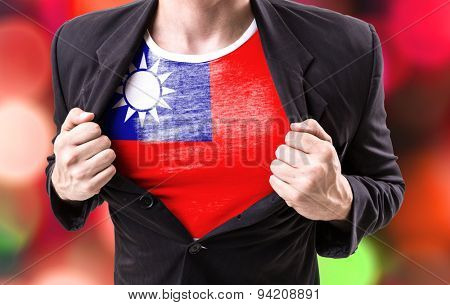 Businessman stretching suit with Taiwan Flag on bokeh background