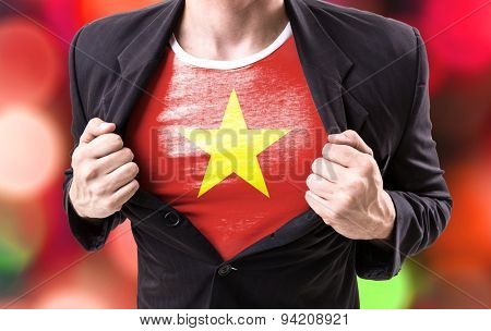 Businessman stretching suit with Vietnam on bokeh background