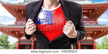 Businessman stretching suit with Taiwan Flag with temple background